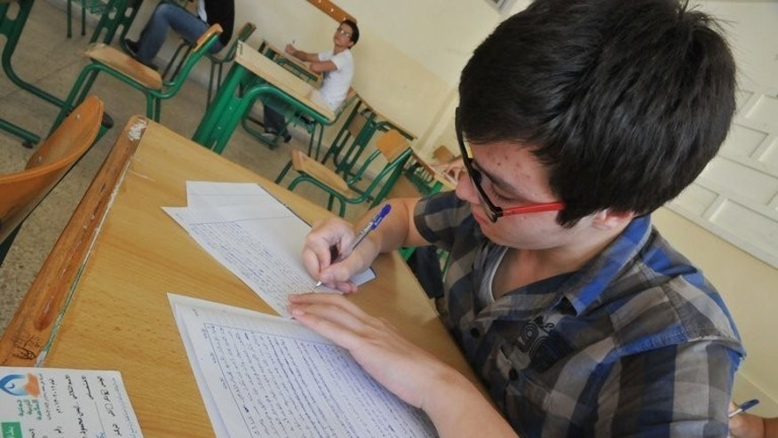 Syrian students take exams in the Lebanese town of Tripoli last week. In Tripoli, north Lebanon's largest city, Some 600 Syrian students are following Lebanon's high school curriculum, thanks to an Islamic charity.