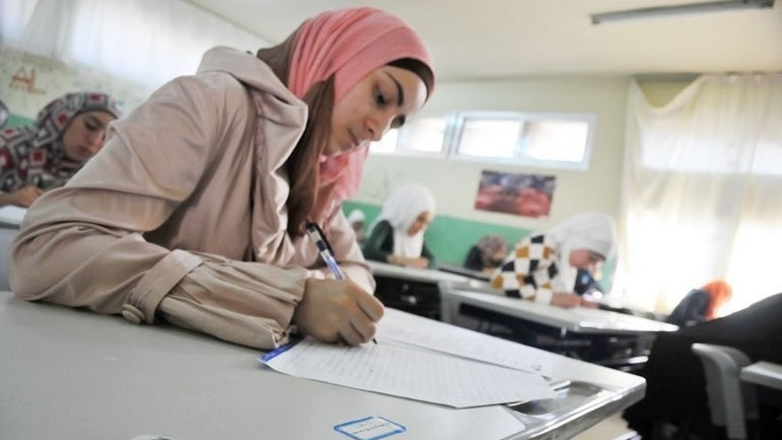Syrian students take exams in the Lebanese town of Tripoli last week. Most of the students sitting the exam fled the war-ravaged central Syrian province of Homs for Tripoli.