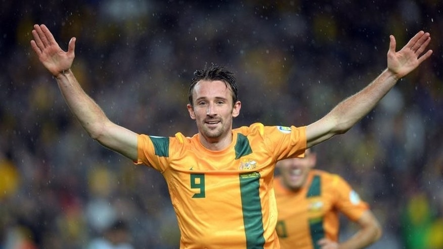 Australia's Josh Kennedy celebrates after scoring against Iraq in Sydney on June 18, 2013. Australia left it late before Kennedy earned a 1-0 win over Iraq in Sydney, enough to take the Socceroos through to their third successive World Cup.