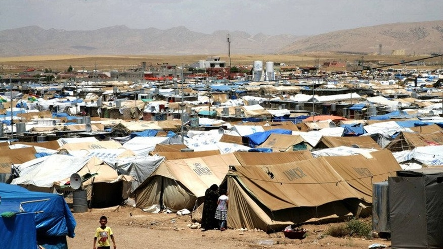 The Domiz refugee camp which houses Syrian-Kurd refugees in the Iraqi city of Dohuk on May 29, 2013. War and other crises drove one person from their home every 4.1 seconds in 2012, the UN's refugee agency said, pushing the number of people forcibly displaced to a two-decade high of 45.2 million.