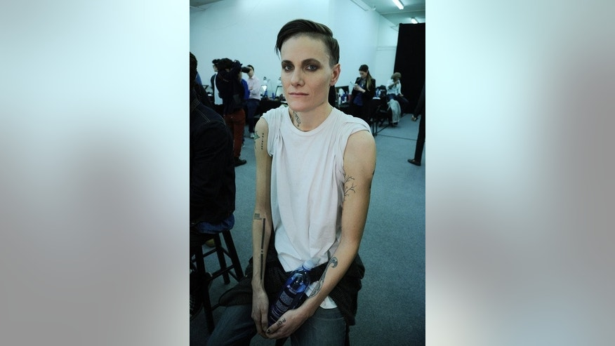 Model Casey Legler prepares backstage at the Michael Bastian show during New York fashion week on February 12, 2013. She is among a small group of female models who have found themselves in demand on the men's catwalk.