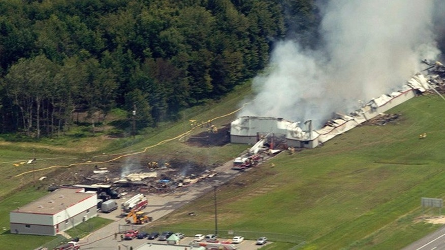 June 20, 2013: Smoke billows from the B.E.M fireworks factory in Coteau du Lac, Quebec, following an explosion. Quebec provincial police are investigating a massive explosion at a fireworks factory west of Montreal.