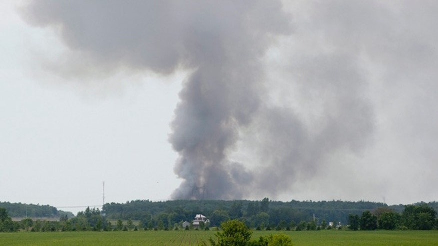 June 20, 2013: Smoke billows from the B.E.M fireworks factory following an explosion in Coteau du Lac, Que. Quebec provincial police are investigating a massive explosion at a fireworks factory west of Montreal. There were no immediate reports of injuries and the cause of the blast is unknown. Police have ordered the surrounding community of Coteau-du-Lac evacuated.