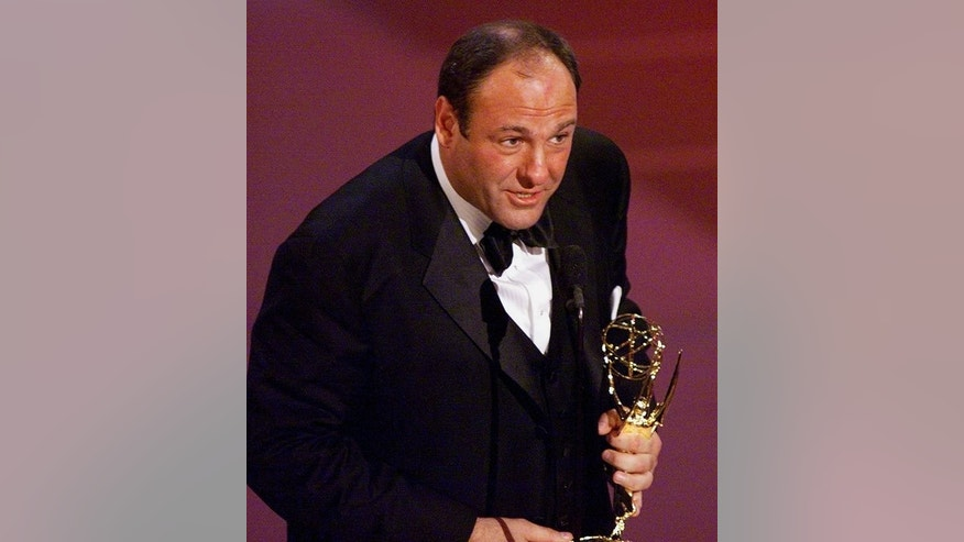 "US actor James Gandolfini accepts his award for ""Lead Actor in a Drama Series"" category for his role in ""The Sopranos"" at the Emmys at the Shrine Auditorium in Los Angeles on September 10, 2000."