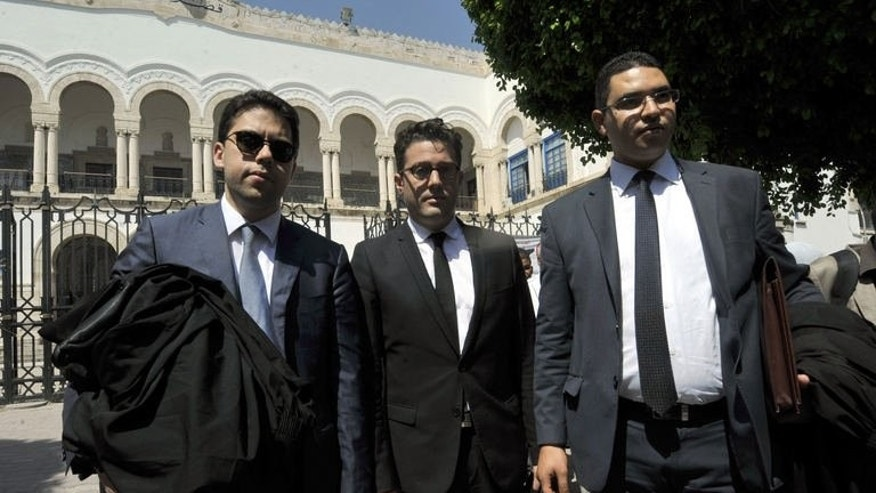 French and Tunisian lawyers representing the three European FEMEN activists who are imprisoned in Tunis, arrive at the court on June 21, 2013 in Tunis.