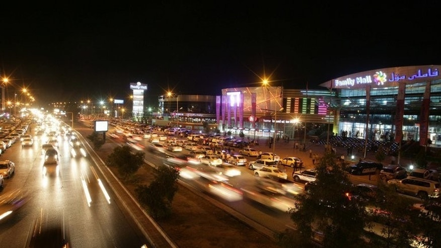 Cars drive past a mall in the northern Iraqi Kurdish city of Arbil on June 20, 2013. As central Iraq grapples with a surge in violence, the economy of the autonomous Kurdish region in northern Iraq, with Arbil as its capital, is growing faster than the rest of the country.