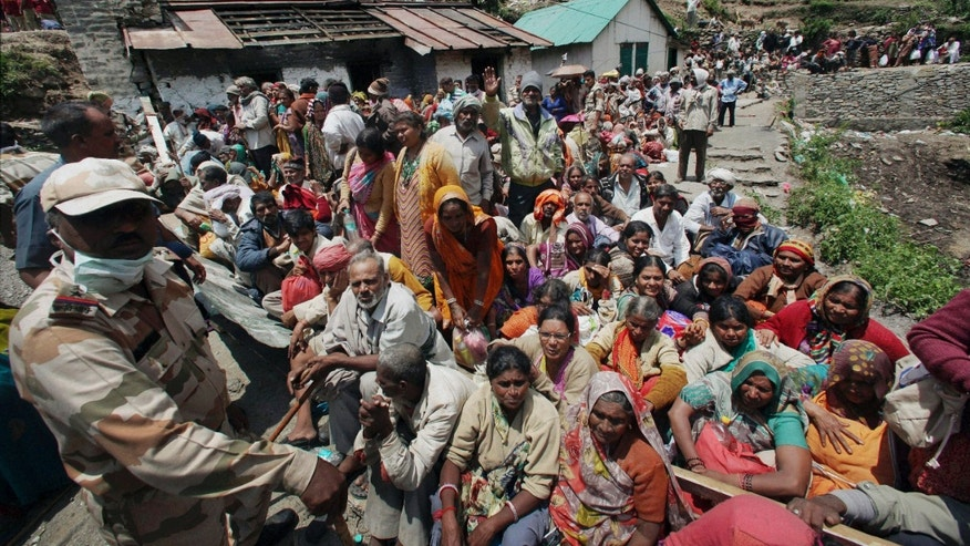 June 21, 2013 - Indian pilgrims wait to be evacuated by the Indian Air Force helicopter to a safer place in northern Indian state of Uttarakhand, India.