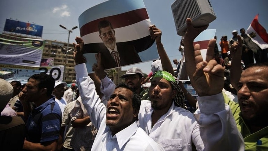 Egyptian Islamists led by the ruling Muslim Brotherhood shout slogans during a demonstration on June 21, 2013 in Cairo to mark the upcoming one year anniversary since President Mohamed Morsi's election.