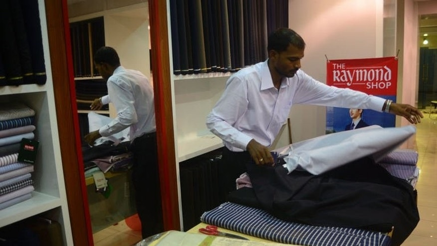 A Pakistani employee works at The Raymond Shop, the first to open in Pakistan, in Karachi on June 21, 2013.