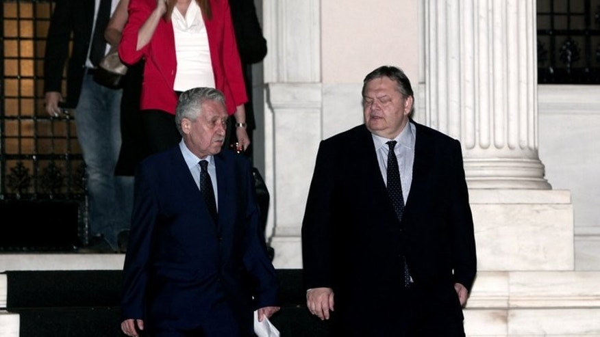The leader of the Greek Socialist party (PASOK), Evangelos Venizelos (R), and the leader of the Left Democratic party (DIMAR), Fotis Kouvelis (L), leave a meeting with the prime minister in Athens on June 19, 2013.