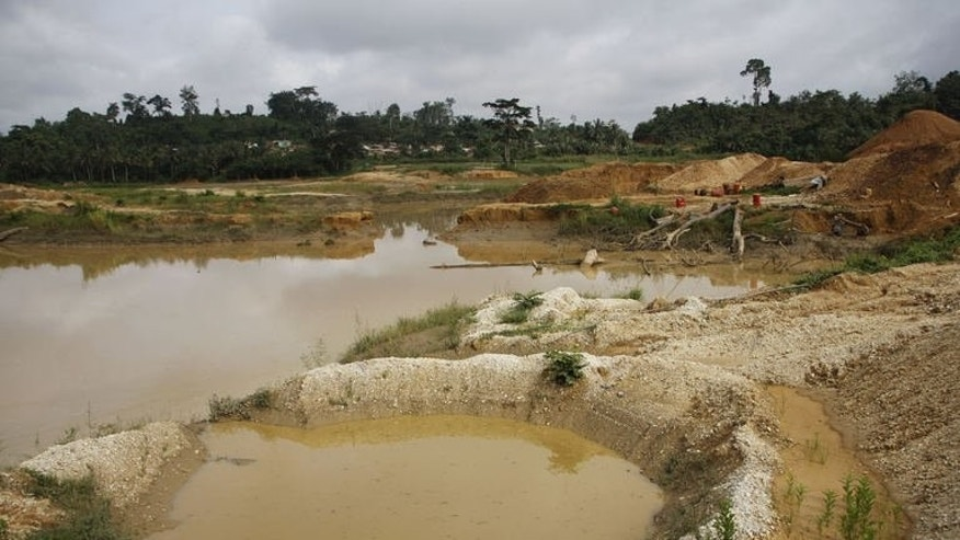 A small-scale mining site once mined by Chinese miners is pictured on June 15, 2013 in Dunkwa-on-Offin in the center of Ghana. Ghana's government last month sent a task force of soldiers, police and immigration officers into the country's gold country to root out foreigners who have flooded mining districts in recent years.