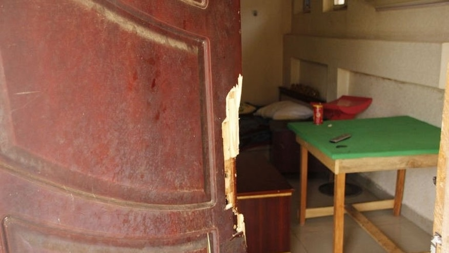 A door that was kicked in by security forces during a raid at the Takyiwa Memorial Paradise Hotel in Dunkwa-on-Offin in the center of Ghana, June 15, 2013.