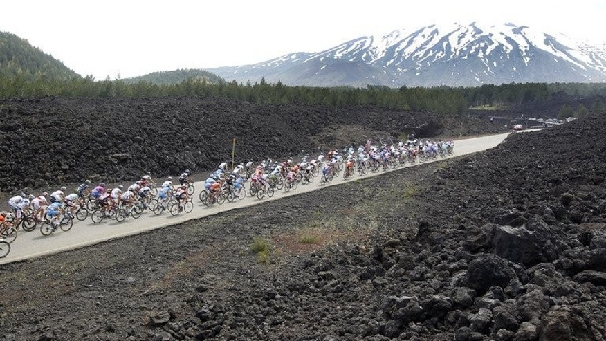 "The Tour of Italy is seen in the shadow of Mount Etna on May 15, 2011. The mountain, one of the world's most ""active and iconic"" volcanoes, has been granted World Heritage status by UNESCO."