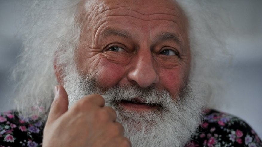 Russian mime Slava Polunin speaks during an interview with AFP at the Big Saint Petersburg Circus office on June 10, 2013. Polunin carefully chooses his words when asked whether the circus will get rid of its many animal numbers and veer toward the more artful western style.