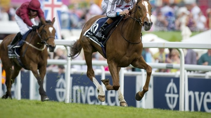 Jockey Richard Hughes rides Talent to victory in The Oaks at the Epsom Derby Festival in Surrey, southern England, on May 31, 2013. Three days of disappointment for Hughes dissolved in an instant when Sky Lantern carried the British champion jockey to a pulsating victory in the Coronation Stakes at Royal Ascot on Friday.