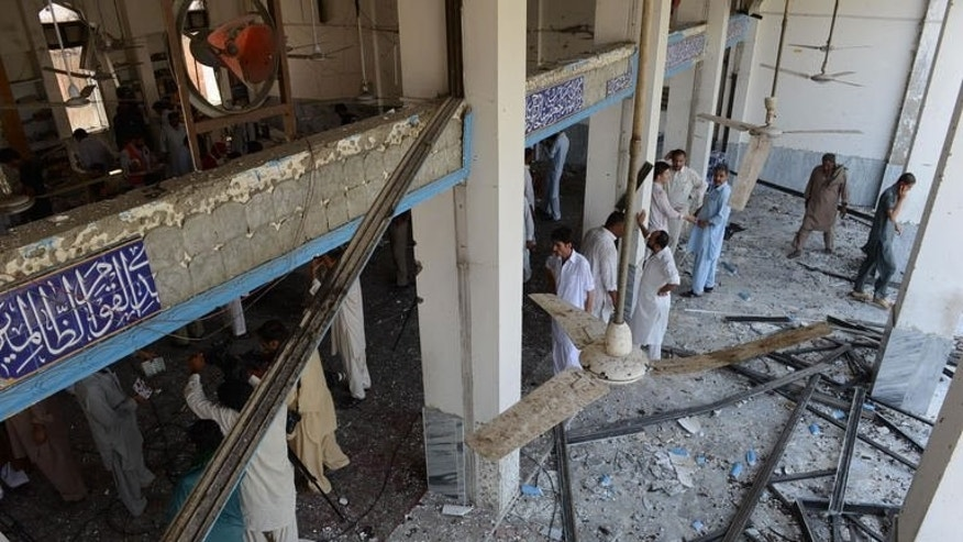 Damage to a Shiite Muslim mosque is seen after a suicide attack in Peshawar on June 21, 2013. A suicide attack on Friday killed 15 people and wounded more than 25 others at a Shiite Muslim mosque and religious seminary on the edge of Pakistan's northwestern city of Peshawar, officials said.