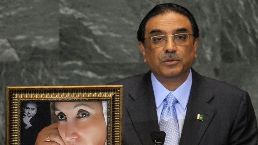 Pakistani President Asif Ali Zardari speaks next to a portrait of his late wife, Benazir Bhutto in New York on September 25, 2009. Swiss prosecutors announced Friday that they had refused to reopen a probe into alleged corruption in the 1990s by current Zardari and his late wife Benazir Bhutto.