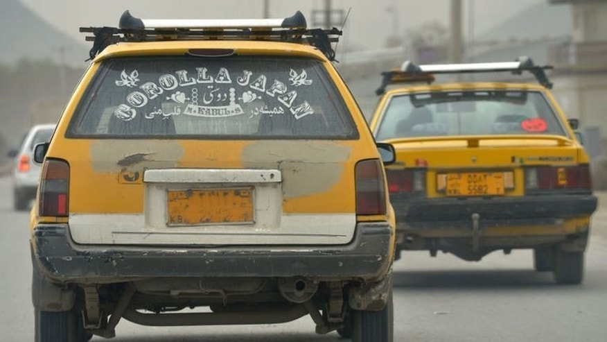 A Toyota Corolla drives through a street in Kabul on April 22, 2013. In a country where even paved roads in the smartest parts of the capital are riddled with pot holes, the sturdy Japanese-made car is the vehicle of choice for all but the richest.