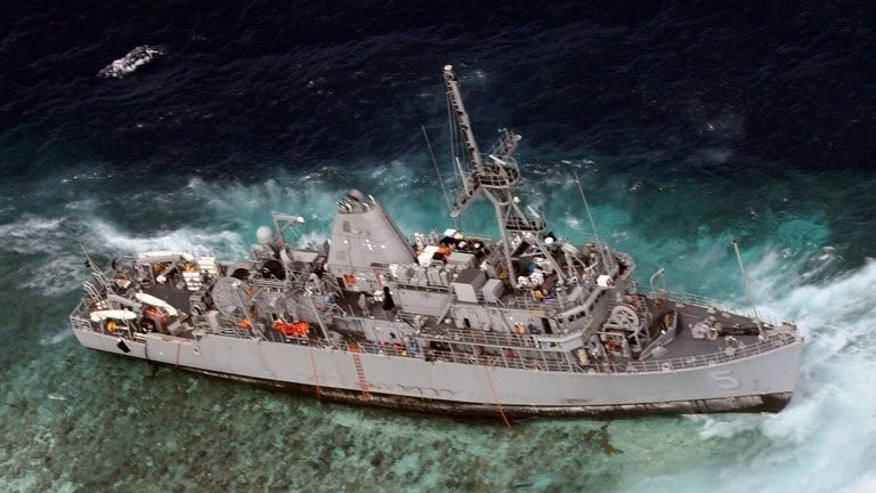 "Photo taken on January 19, 2013 and released on January 20 by the Philippine Western Command (WESCOM) shows an aerial shot of US Navy minesweeper, the USS Guardian, after it ran aground on the protected Tubbataha coral reef near the western Philippine island of Palawan. The ship was doomed by its top officers' ""lack of leadership"", the US Navy has concluded in a report released Friday."