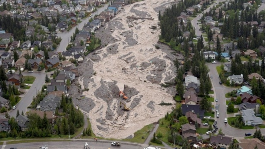 June 21, 2013: The flooded Cougar Creek runs through Canmore, Alberta.
