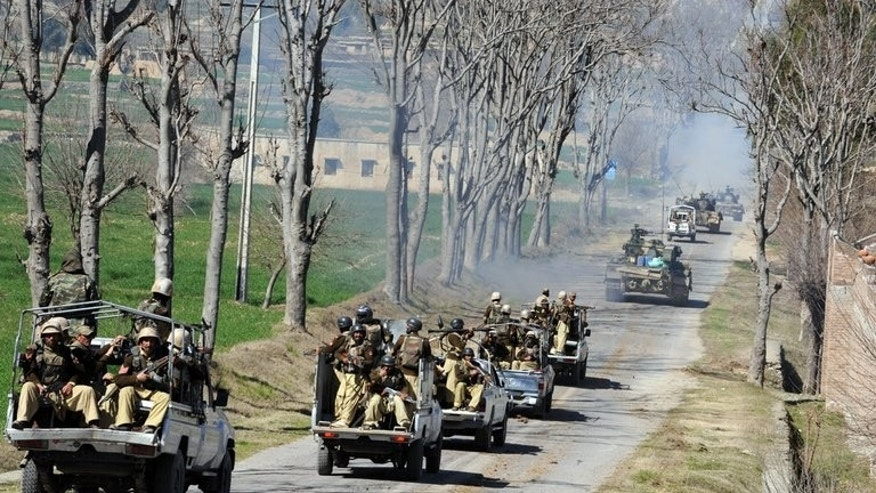 Pakistani soldiers ride on trucks in the remote Bajaur Agency, on February 28, 2009. A bomb explosion has killed two members of a Pakistani pro-government militia in a tribal region near the Afghanistan border.