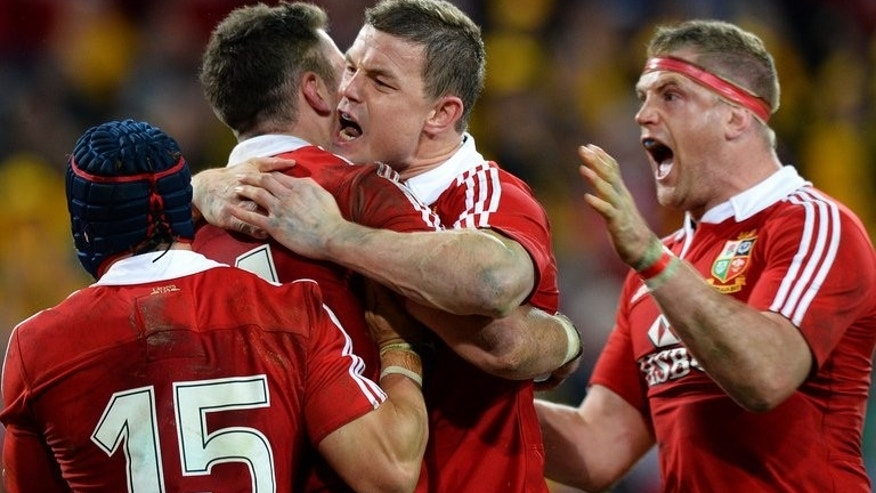 "The British and Irish Lions celebrate Alex Cuthbert's try against Australia on June 22, 2013. The thrilling 23-21 first Test win over Australia was ""larceny"" and the rest of the series will be a similarly nerve-shredding affair, Britain's newspapers warned."
