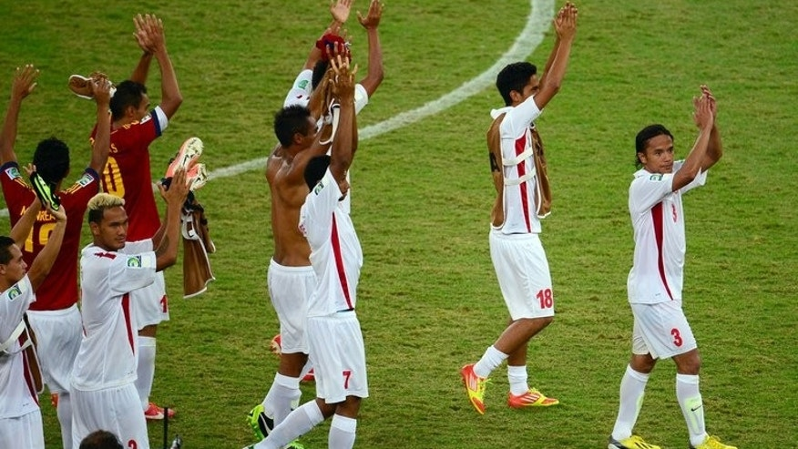 The Tahiti players acknowledge the crowd at the end of their Confederations Cup match to Spain on June 20, 2013. Tahiti will bow out Sunday against Uruguay to end what was a romantic adventure -- even if they slid to a record 10-0 loss to Spain along the way.