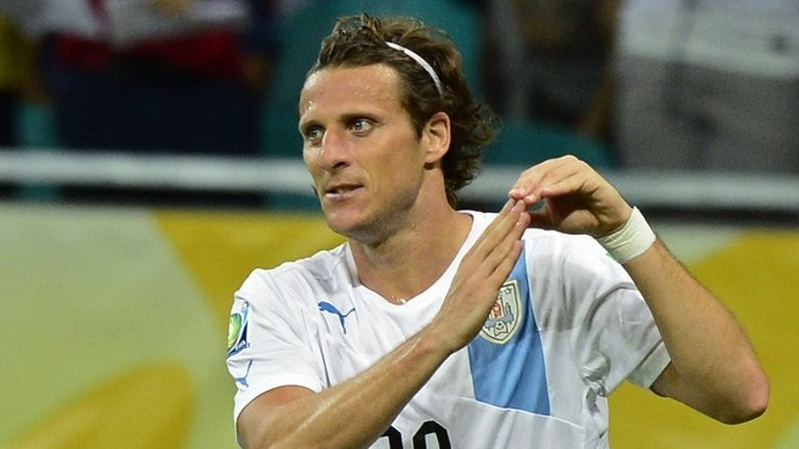 Uruguay forward Diego Forlan celebrates after scoring against Nigeria in the Confederations Cup on June 20, 2013. The Uruguayans are struggling to impress in the Latin American zonal qualifying tournament for next year's World Cup finals.