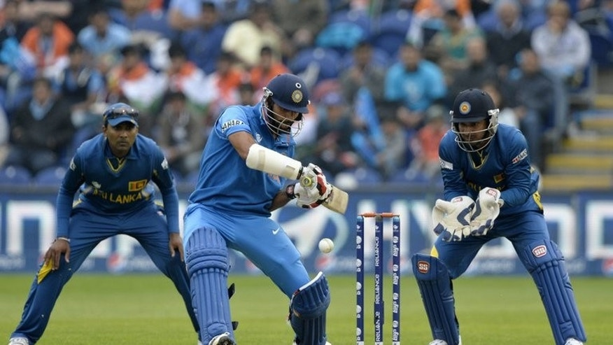 India's Shikhar Dhawan plays a shot against Sri Lanka during their Champions Trophy semi-final on June 20, 2013. The left-handed opener Dhawan has taken the tournament by storm with 332 runs in four matches at an average of 110.66.