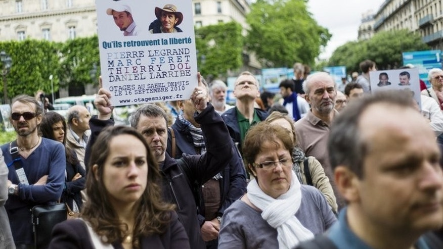 People gather in support of the four French hostages kidnapped in 2010 in Niger to mark their 1000-day captivity, Paris, June 22, 2013. Over a thousand people demonstrated in several towns and cities in France on Saturday in a show of support for the hostages.
