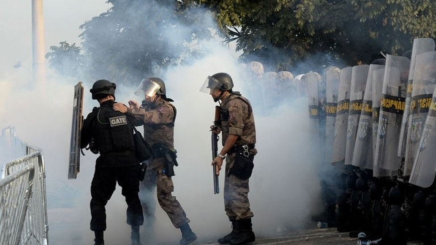 Anti riot police members block a street near the Mineirao stadium in Belo Horizonte, Brazill during a demonstrate against corruption and price hikes on June 22, 2013.