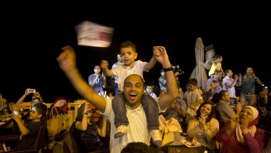 "People celebrate Palestinian singer Mohammed Assaf winning ""Arab Idol"" in Gaza City on June 22, 2013. The 22-year-old Assaf, from the Gaza Strip, was named the winner in Beirut."