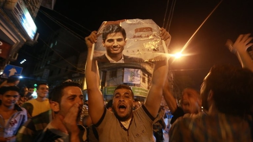 "People celebrate the winning of Palestinian singer Mohammed Assaf in Gaza City, June 22, 2013. The 22-year-old Assaf, from the Gaza Strip, was named the winner of ""Arab Idol"" in a TV talent contest in Beirut."