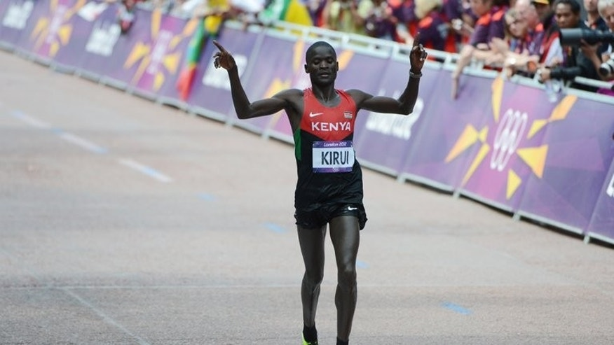 Kenya's Abel Kirui celebrates as he crosses the finish line to win silver in the men's marathon during the London Olympic Games on August 12, 2012. Kirui has pulled out of the world athletics championships in Moscow due to a persistent leg injury, the two-time world marathon champion said on Saturday.