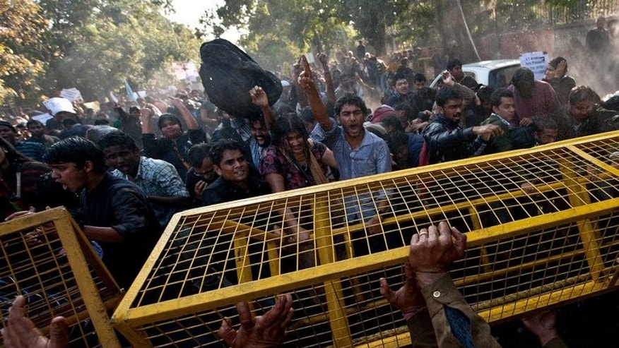 Indian students scuffle with police during a protest outside the Sri Ram College of Commerce in New Delhi on February 6, 2013 over an appearance by controversial politician Narendra Modi. The United States has refused to issue Modi a visa due to allegations he turned a blind eye or worse to anti-Muslim riots in 2002
