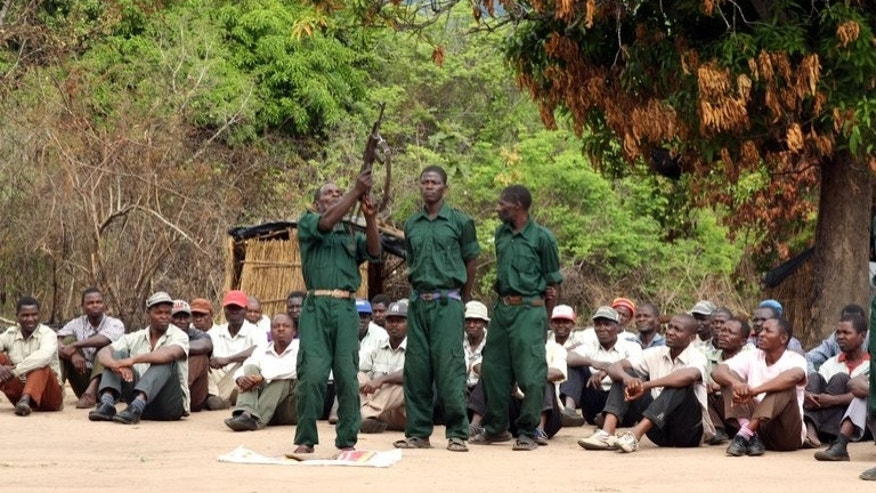 "Fighters of former Mozambican rebel movement ""Renamo"" receive military training on November 8, 2012 in Gorongosa's mountains. Activists of Mozambique's ruling Frelimo party staged nationwide marches to protest against deadly armed attacks suspected to have been carried out by Renamo that rocked the country the day before."