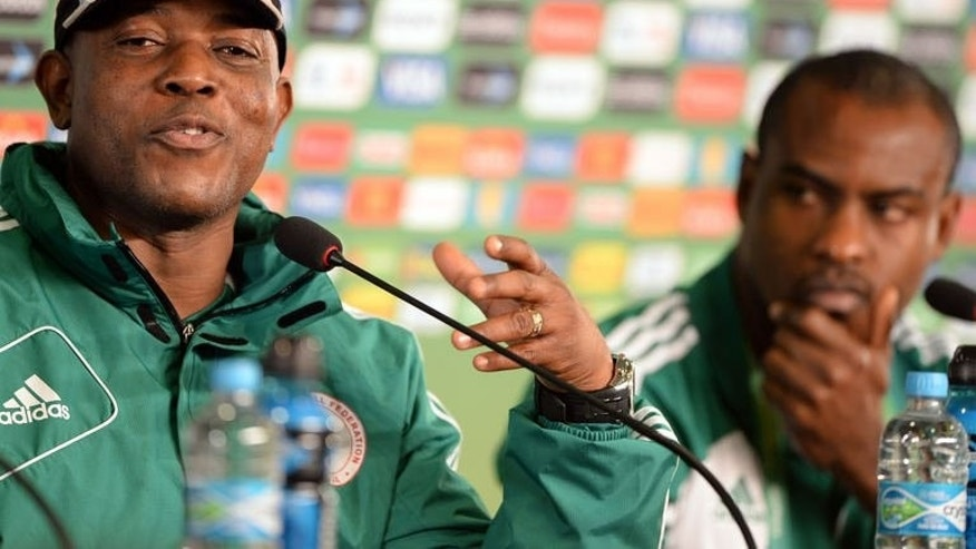 Nigeria's coach Stephen Keshi (L) speaks next to Nigeria's goalkeeper Vincent Enyeama during a press conference in Fortaleza on June 22, 2013. Nigeria will face Spain in their next Confederation Cup football match.