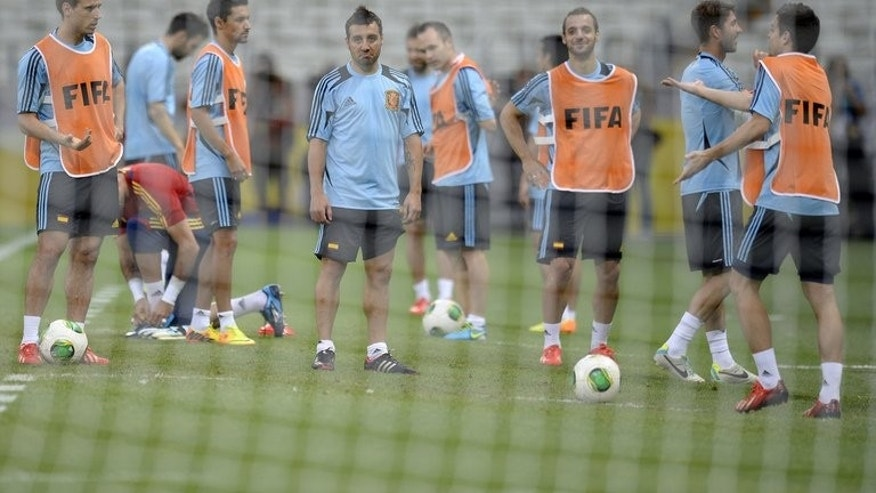 Spain's players take part in a training session in Fortaleza on June 22, 2013. Buoyed by their record-breaking 10-0 rout of Tahiti at the Confederations Cup, Spain approach Sunday's final Group B fixture against Nigeria needing just a point to secure a place in the semi-finals.