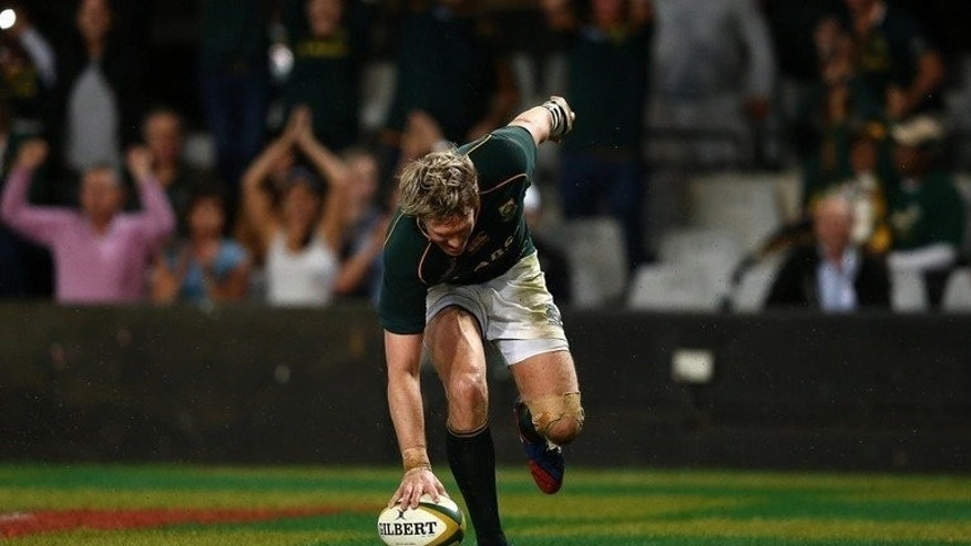 Jean De Villiers, South Africa's captain, scores a try against Italy in Durban, on June 8, 2013. South Africa are wary of Samoa before they clash in the four-nation tournament final on Saturday despite a string of large victories over the Pacific islanders.