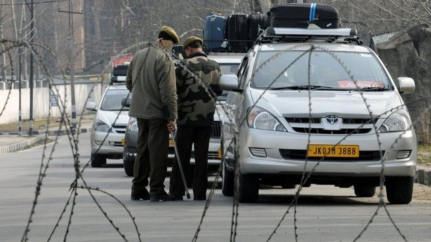 Indian police guard a checkpoint in Srinagar, on February 11, 2013. Two Indian policemen have been shot dead by suspected militants in a high security area of Srinagar, the summer capital of Indian Kashmir.