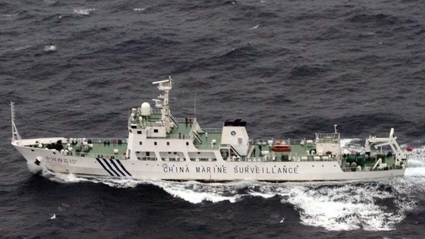 This photo, taken by the Japan Coast Guard on April 23, 2013, shows a Chinese marine surveillance ship cruising near the disputed islets -- known as the Senkaku in Japan and Diaoyu islands in China -- in the East China Sea. Three Chinese government ships have sailed into waters around disputed islands controlled by Tokyo, according to the Japanese coastguard.