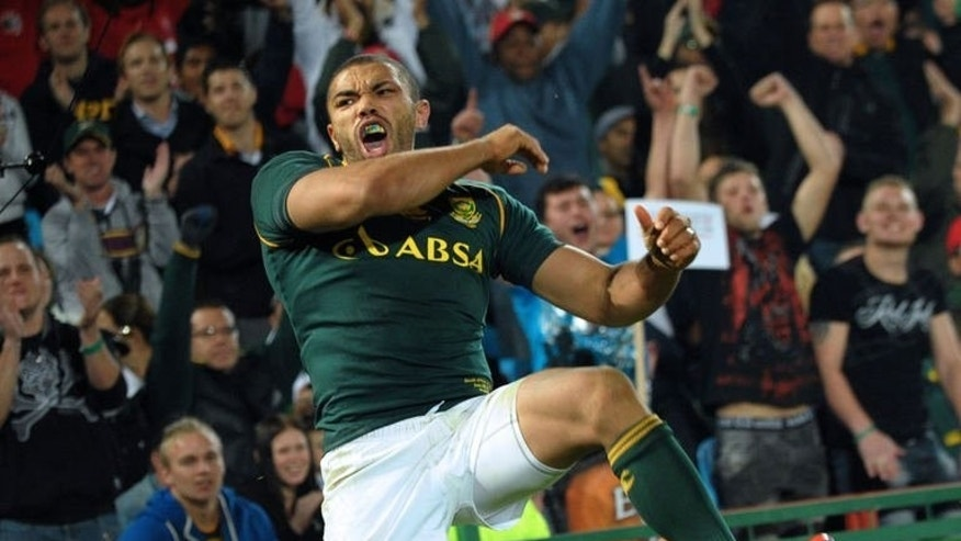 South African player Bryan Habana celebrates after scoring his 50th try against Samoa during the four-nation tournament rugby final in Pretoria on June 22, 2013. South Africa scored eight tries en route to a 56-23 triumph over Samoa Saturday in a four-nation tournament final after leading by 23 points at half-time.