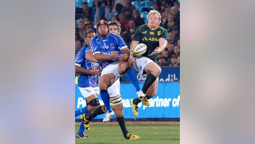 Samoa's player Wayne Ole Avei (L) fights for the ball with South African player Adriaan Strauss (R) during the four-nation tournament rugby final in Pretoria on June 22, 2013. South Africa defeated 14-man Samoa 56-23.
