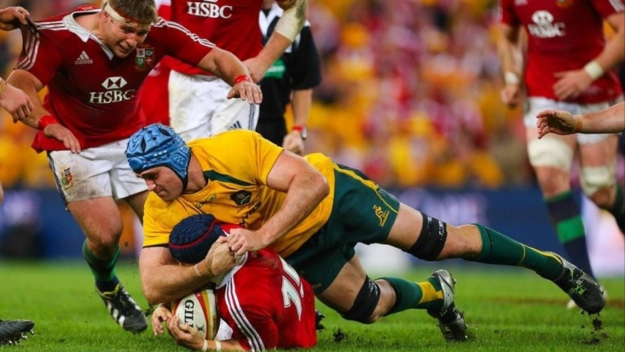 "Australian captain James Horwill tackles British and Irish Lions' Leigh Halfpenny on June 22, 2013. Horwill has been cited for ""stamping or trampling"" lock Alun Wyn Jones during the Wallabies' loss to the Lions."