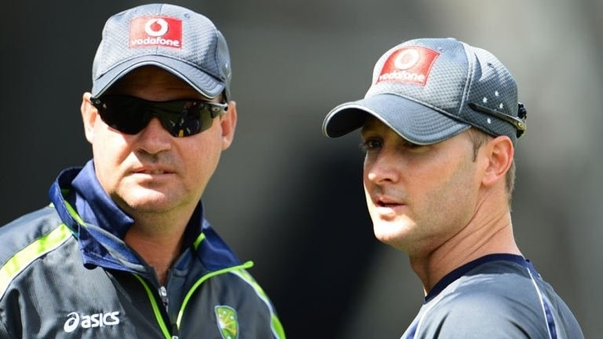 File photo of Australian national cricket team coach Mickey Arthur (L) and captain Michael Clarke, pictured during a training session in Melbourne, on December 25, 2012. Arthur has been sensationally sacked on the eve of the Ashes series with England, according to reports and sources.