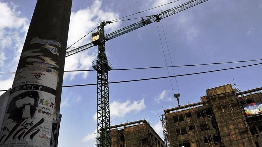 A crane stands at a construction site in a neighbourhood undergoing a facelift in Addis Ababa on June 19, 2013. Ethiopia's burgeoning diaspora community is returning home to invest in its booming economy.