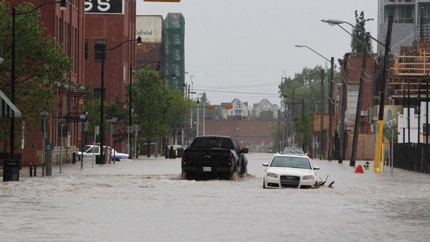 Downtown Calgary stands flooded with rising waters from torrential rain and swollen rivers in Alberta, Canada, on June 21, 2013. Canadian authorities in the western city of Medicine Hat ordered Sunday the evacuation of buildings in low-lying areas a day after flooding killed three people and forced 100,000 to leave Calgary.