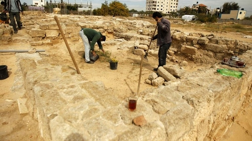 A picture taken on March 19, 2013 shows Palestinian workers cleaning a section of the archaeological site of the Saint Hilarion Monastery, in the central Gaza Strip. A haven of peace in a sea of concrete that is the Gaza Strip, the crumbling remains of the Holy Land's oldest monastery are in danger of disappearing for lack of funds to preserve them.