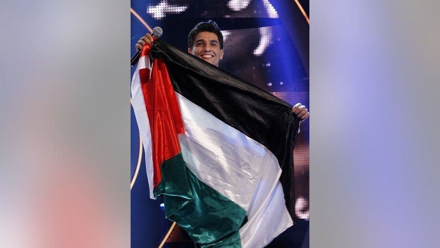"Palestinian singer Mohammed Assaf celebrates after winning the ""Arab Idol"" singing contest in Beirut, on June 23, 2013."