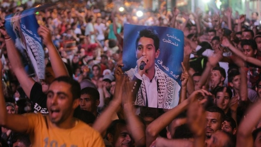 Thousands of Palestinians from Ramallah celebrating the victory in the Arab Idol contestant of Mohammed Assaf on June 23, 2013.